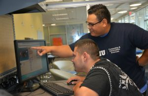 Young adults with developmental disabilities bond with FIU peers over computers