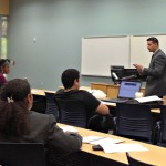 Jose Paonessa (right) talks to students about money management.