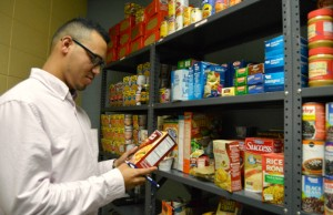William Solis takes inventory of new donations at the MMC food pantry.
