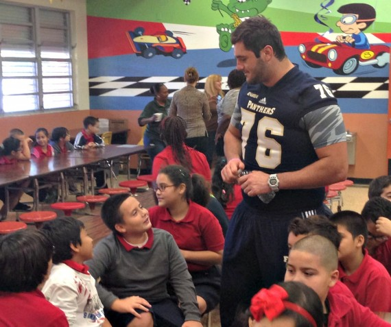 FIU football players encourage students at James H. Bright Elementary School