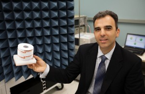 Stavros V. Georgakopoulos, assistant professor at FIU's Department of Electrical and Computer Engineering, with an origami antenna.