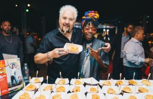 Student presents original burger to Guy Fieri at SOBEWFF®