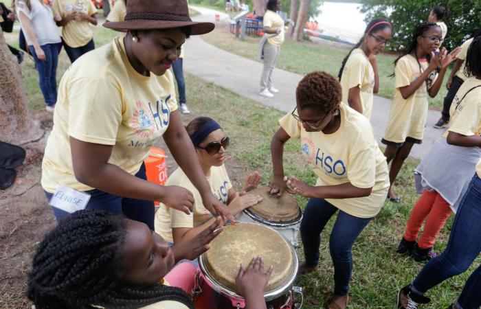 HSO volunteer mentors bang on the drums.