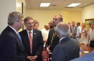 United States Secretary of Agriculture Tom Vilsack, Rep Joe Garcia, Dean Michael Heithaus.