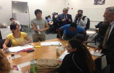 Dr. Holdren interacts with FIU students throughout tour of labs