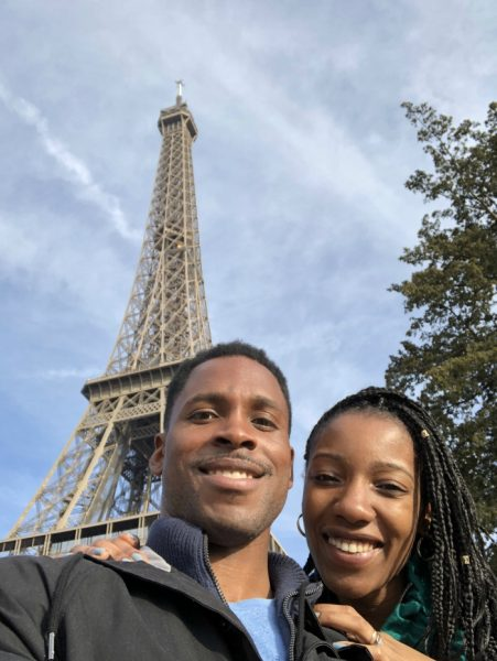 Lamar Burton and his wife posing next to the Eiffel Tower.