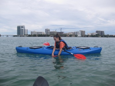FIU dual enrollment student Rebecca Rauch-Thane collects water samples in the estuary adjacent to FIU's Biscayne Bay Campus and Oleta River State Park.
