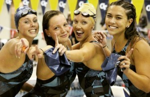 FIU swimming and diving team members Kyna Pereira, Skye Carey, Becky Wilde and Jessica Piper (left to right) celebrate after the team won its second consecutive Conference USA title Feb. 27 after scoring the second-most points in C-USA Championship history.