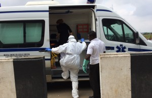 Dr. Marty, in protective gear, transporting suspected case to Ebola ward in Nigeria.