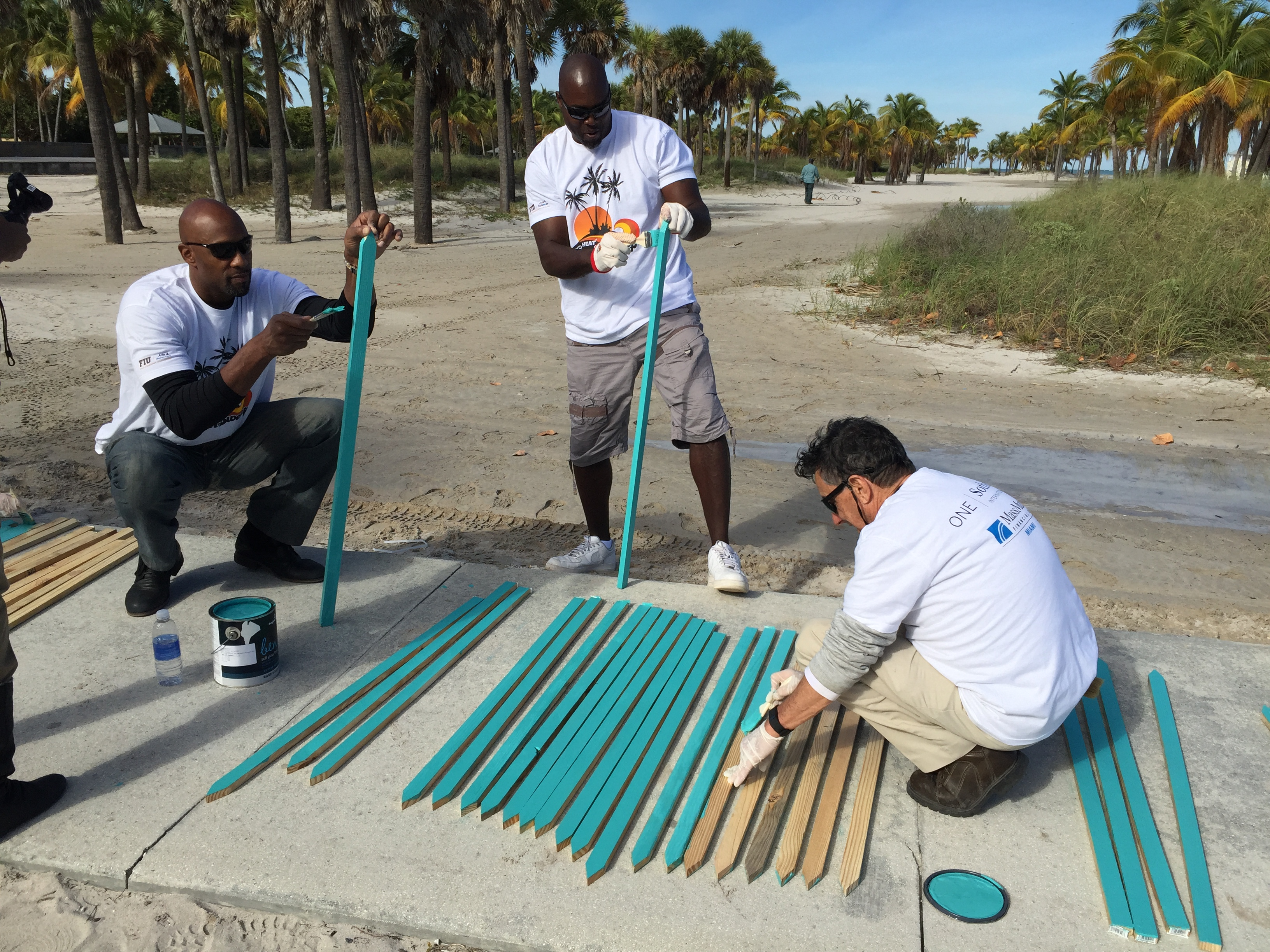 Miami Heat alumni Alonzo Mourning (left) and Glen Rice (center) helped paint and prepare sea turtle nesting sites.