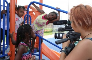 FIU journalism student Karnkamol Intarasuwan shoots video for the Liberty Square Rising project.