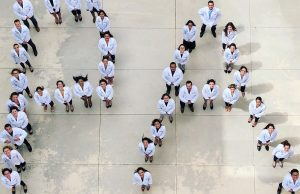 HWCOM PA Class of 2019 poses with their newly donned white coats.