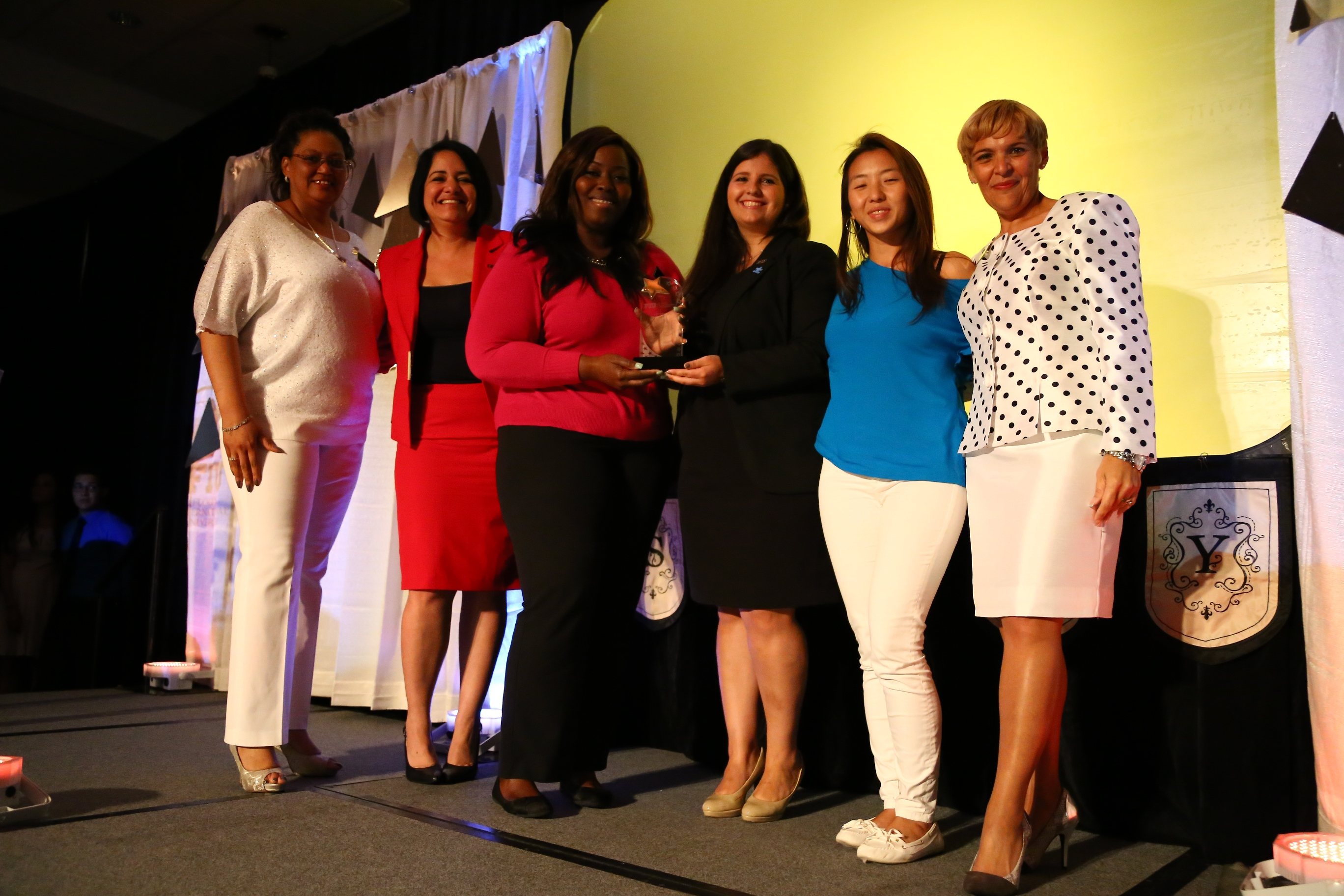Shantell Rolle receives her SEOTY award. From left to right: Adelfa Ukenye, Luisa Havens, Shantell Rolle, Liane Sippin, Fu Zhou Wu and Ana Jimenez.