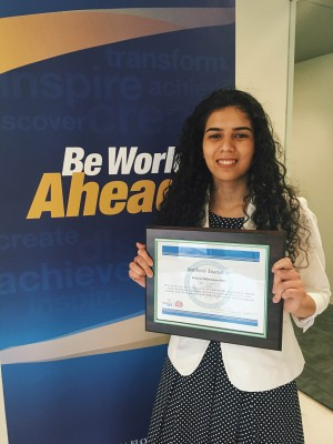 FIU Green School student and U.S. Dept. of State Diplomacy Lab Fair and Wonk Tank Competition finalist Eshrat Nikrooye-Asli poses with honorary plaque