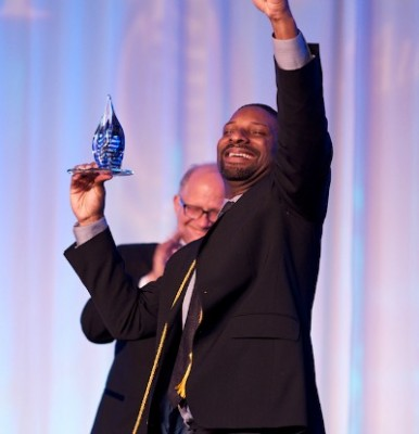 Grocher, better known as DJ Irie, received the Charles E. Perry Young Alumni Visionary Torch Award in 2012.