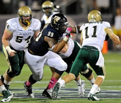 FIU defensive tackle Isame Faciane (99) pressures UAB quarterback Austin Brown (11) in FIU's Homecoming game on Oct. 12