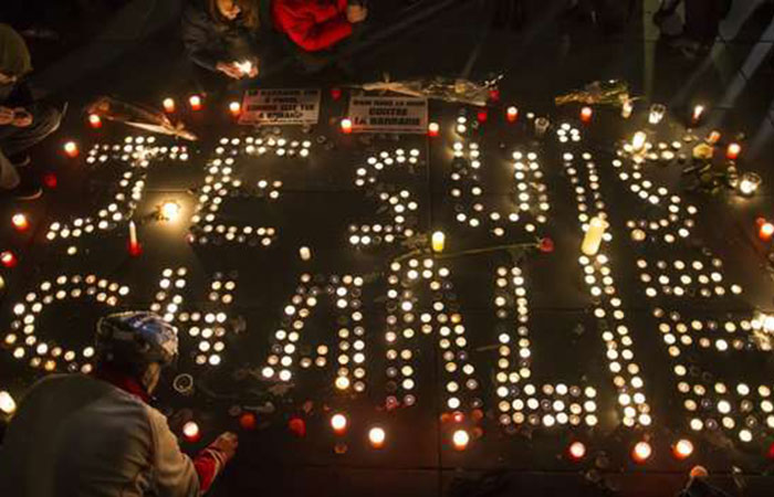 """Candles spell out """"Je Suis Charlie"""" - I am Charlie during a demonstration of support for the satirical newspaper."""
