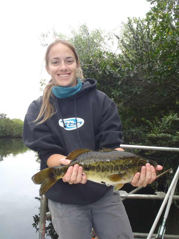 Environmental studies graduate student Jessica Lee poses with a fish in the Everglades.
