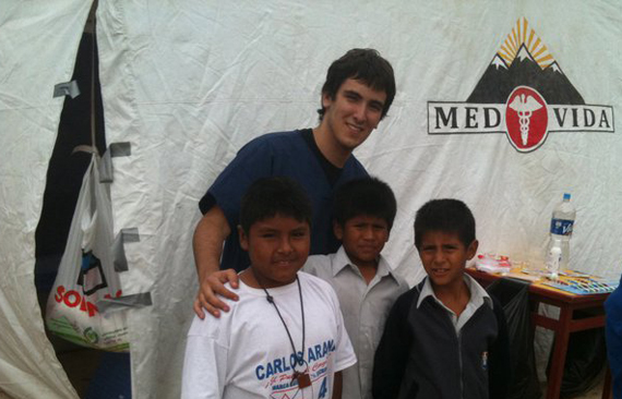 Jose Orta poses with local children in Peru during a MEDLIFE at FIU trip in 2010.