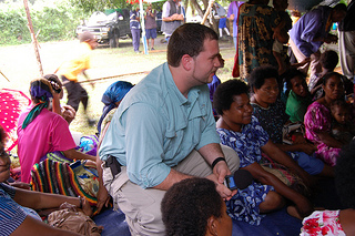 Religious Studies student Kyle Decker talks with tribe members at one the gatherings hosted in our honor in Balimo.