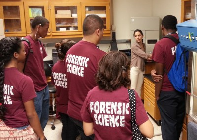 Beatrice Kallifatidis, coordinator for IFRI's Forensic DNA Profiling Facility, gives LEOMHS students a tour of the facility.