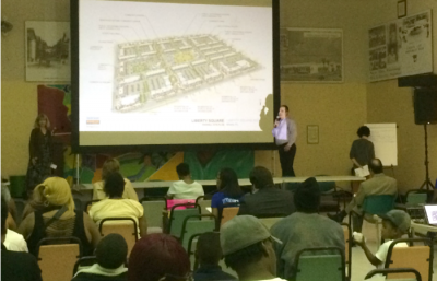 Nepomechie and a representative from the development team present the final redevelopment design to Liberty Square residents, while Crismary Pascarella MArch '15 notes residents' input.