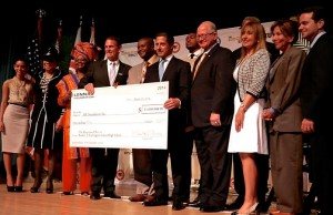 The Lennar Foundation presented a check to FIU to launch The Education Effect at Booker T. Washington Senior High School in Overtown.