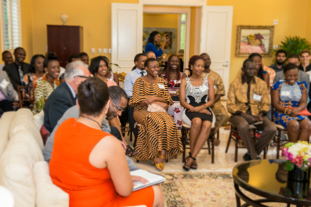 Lindiwe Dlamini, center, attends a parlor event at the President's House with her fellow YALI participants.