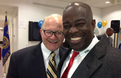 "FIU President Mark B. Rosenberg joins Miami Northwestern Principal Wallace Aristide in celebrating the school's ""A"" grade, the first in its history."