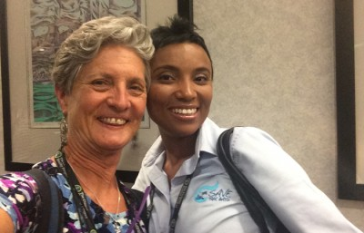 FIU biology professor Maureen Donnelly poses with former student Vanessa Haley at the Climate Reality Leadership Corps Training.