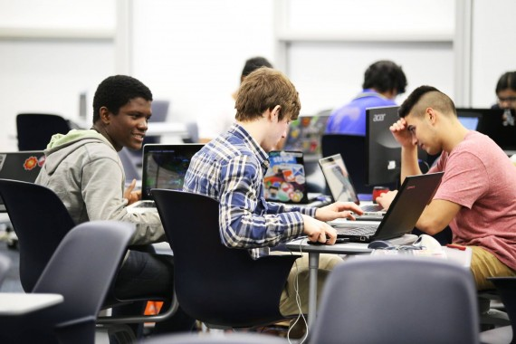 FIU students Kerlin Michel, Mark Fajet and Lester Ramos working during MangoHacks.