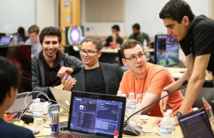 From left to right: Florida Atlantic University student Baruch Hen, FIU student  Jose Morgan, MangoHacks mentor and University of Florida student Jacob Jenkins (UF), and FIU student Lukas Borges discussing during MangoHakcs