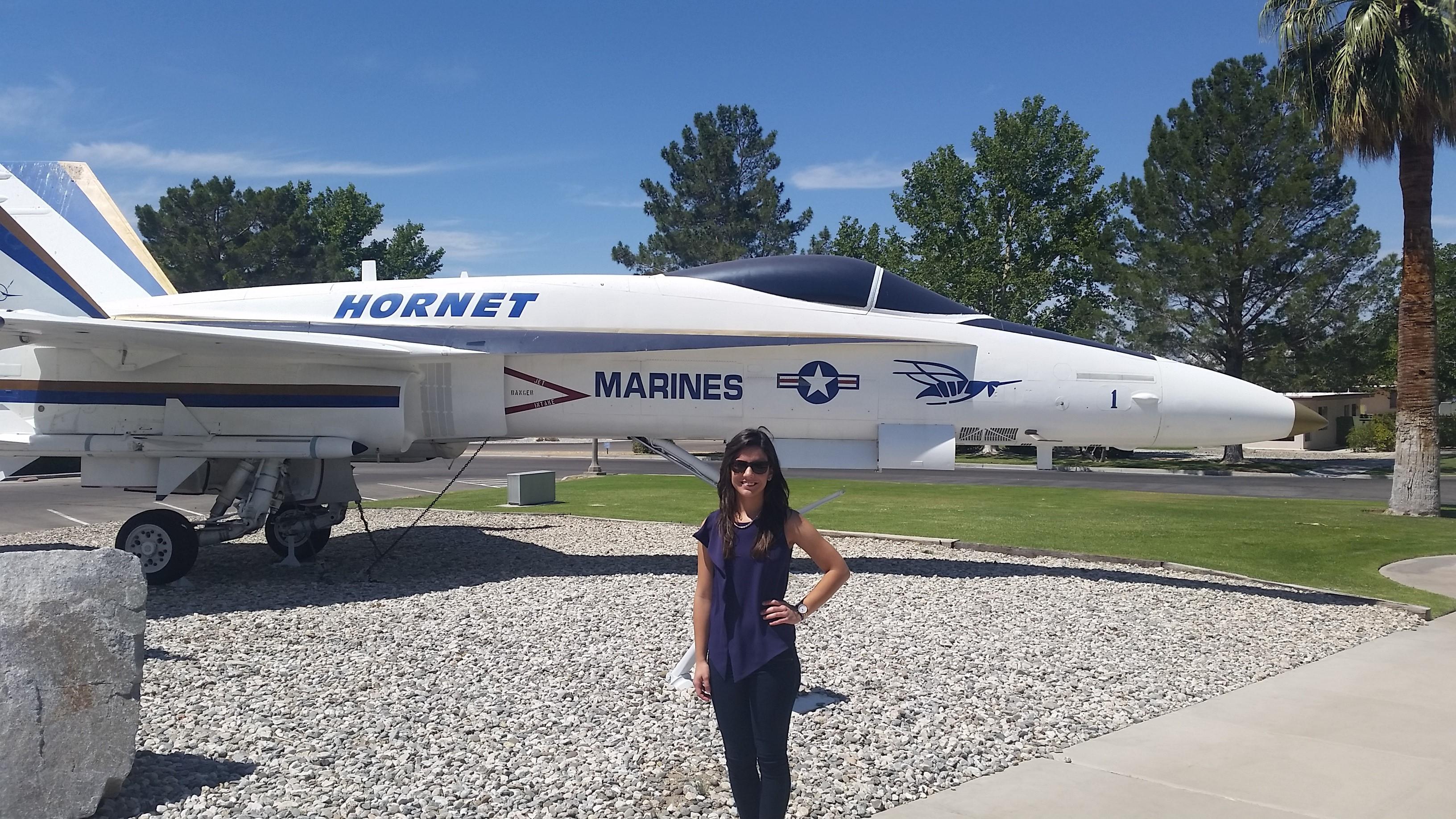 Karina Quintana, flight test engineer at Boeing, by Hornet aircraft.