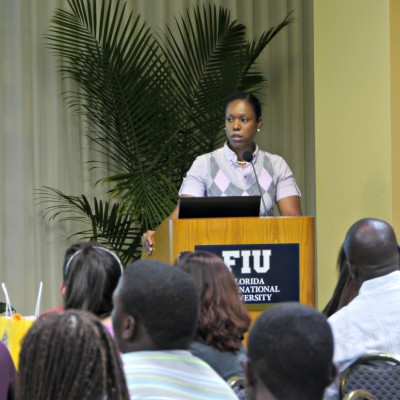 Courtenay McClain addresses new class of Golden Scholars students at their welcome reception.