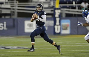 15 November 2014:  FIU quarterback Alex McGough (12) scrambles in the third quarter as the FIU Golden Panthers defeated the Middle Tennessee Blue Raiders, 38-28, at FIU Stadium in Miami, Florida.