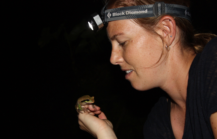 Thompson holds a frog in Costa Rica.