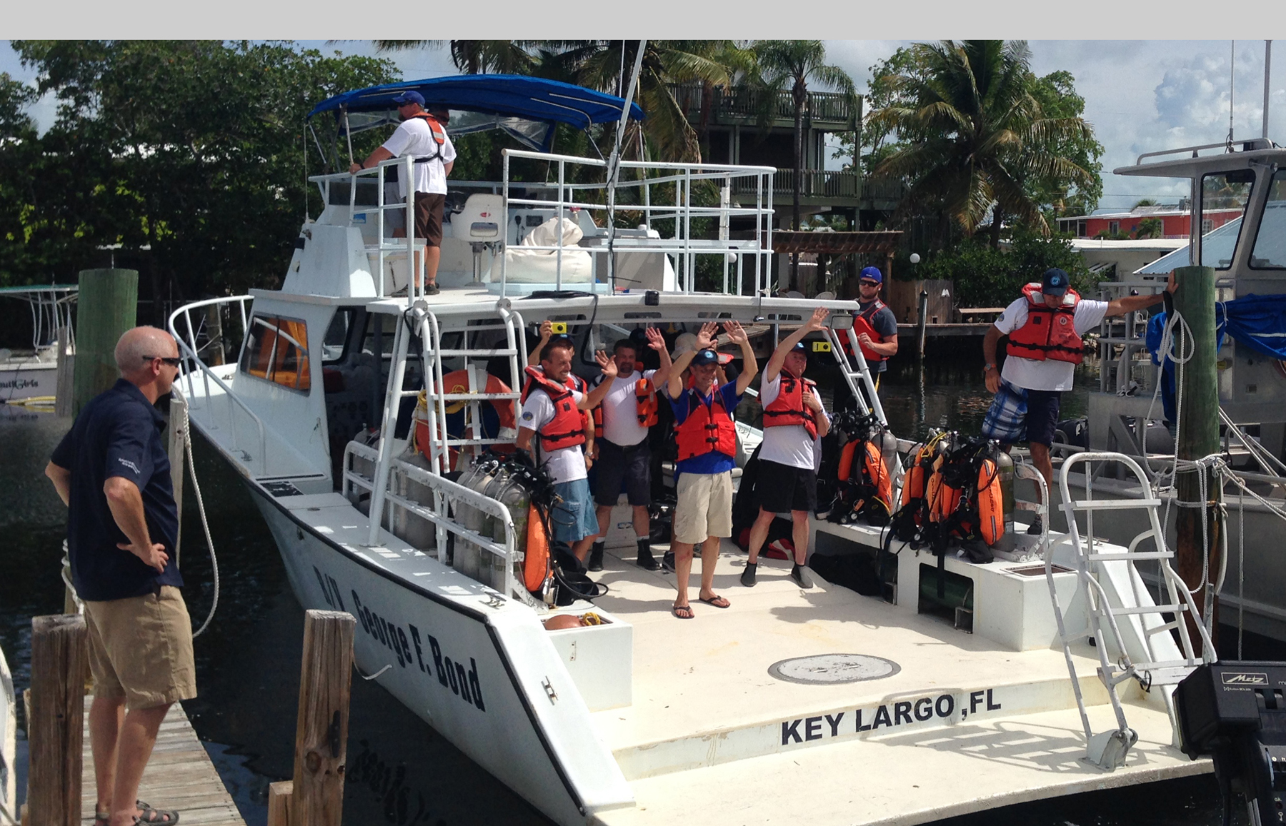 Fabian Cousteau, members of the Mission 31 team and members of the FIU Aquarius Reef Base crew head out to sea for the splash down of Mission 31.
