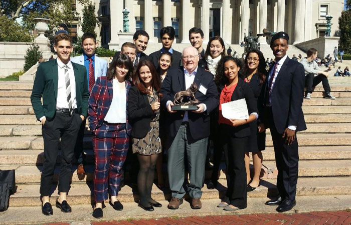 "The FIU Model UN team poses with Dr. John Stack, executive director of the School of International and Public Affairs, after winning ""Best Small Delegation"" at the Columbia Model United Nations in early Oct. 2014."