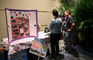 "FIU NOW display, recounting the ""Slut Walk"" and other signs encouraging survivors not be blamed for what they experienced."