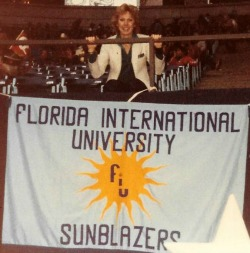 Nancy Olson with FIU Banner