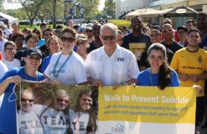 Adriana Tresppalacios (far left), chair of the Walk, pictured with Mark B. Rosenberg, FIU President, and her sister, Alejandra Ares, FIU student.