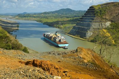 A cargo ship in the Panama Canal passes through volcanic rocks that helped form the Isthmus of Panama. Credit: Aaron O'Dea
