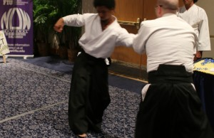 Panther Aikido member James Ashe (senior) and instructor Cedric Capestany demonstrate methods of self defense.