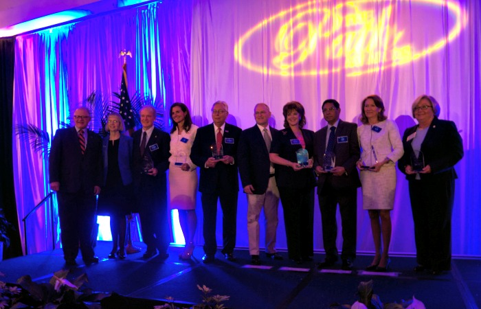 The 2014 Path Awards recipients stand with President Mark B. Rosenberg (far left) and Dean Michele Ciccazo (second from left).