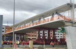 "First-of-its-kind pedestrian bridge ""swings"" into place"