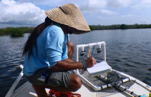 FIU researcher Rolando Santos examines baited remote underwater video to study fish in newly opened Joe Bay.