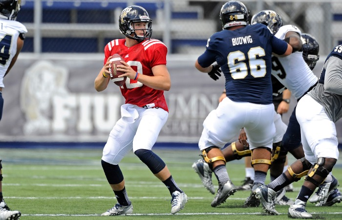 Football shows progress on offense and defense during 2014 spring game