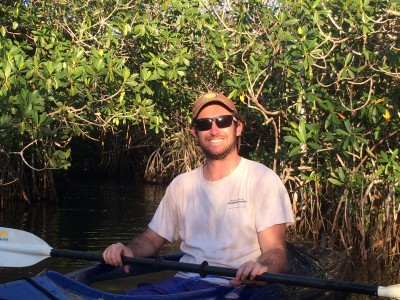 Biology student Sean Charles enjoys kayaking in the Everglades. The researcher is studying the effects of sea level rise on Florida mangroves and their ecosystems.