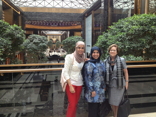 Al-Tammar (left), Salwa (center) and Newman (right) pose in Kuwait City.
