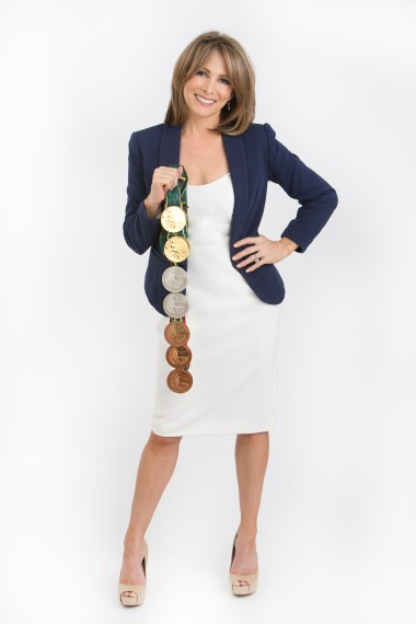 Shannon Miller Standing with Medals.jpg